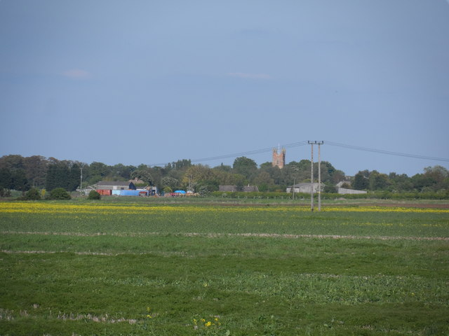 Tower of All Saints Church Cottenham from across the fields