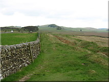 NY8270 : The Hadrian's Wall Path and the Ditch heading for Sewingshields by David Purchase