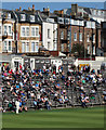 TA0389 : Watching cricket at Scarborough by John Sutton