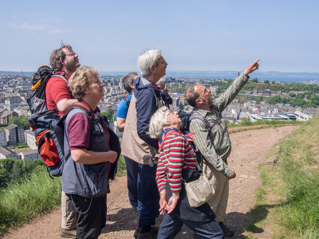 Guided group on a geology walk study the Cat Nick intrusion