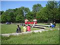 NT2673 : Scottish Parliament landscape Zone 1 and tour bus by Robin Stott
