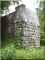 NJ8400 : A road bridge abutment by the Old Deeside Railway track by Stanley Howe