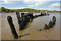 NX6548 : A shipwreck in Nun Mill Bay by Walter Baxter
