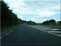 NS3337 : Slip road from the A78 to the A71 at Warrix Interchange by Colin Pyle