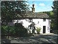 SJ9475 : Pink cottage on Hawkins Lane, Rainow by Raymond Knapman