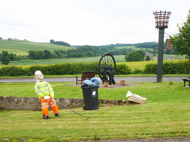 Council worker by the Golden Jubilee Beacon, Fourstones