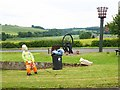 NY8867 : Council worker by the Golden Jubilee Beacon, Fourstones by Oliver Dixon