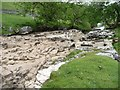 SD8880 : Dry waterfall on the River Wharfe by Christine Johnstone