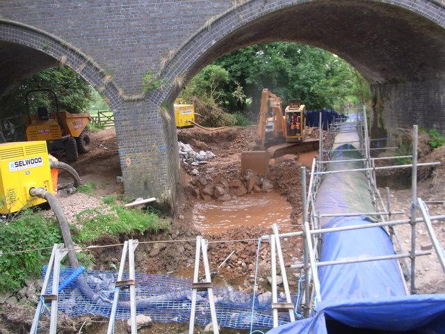 Contractors working to reinforce the bridge foundations