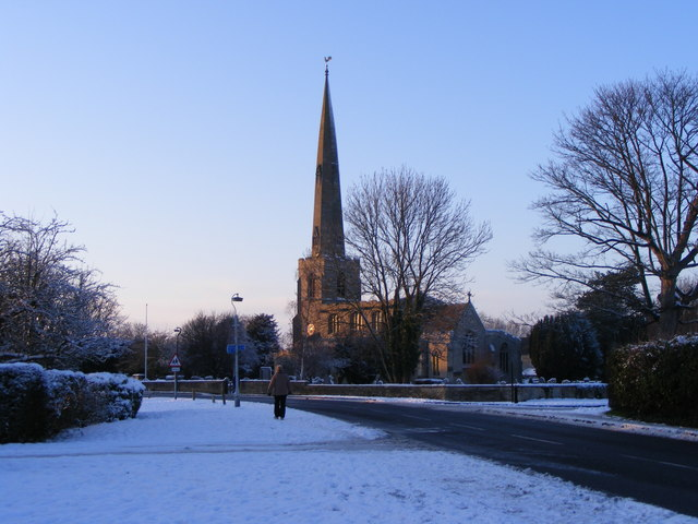 High Street and St. Benedict's Church, Glinton, in the winter