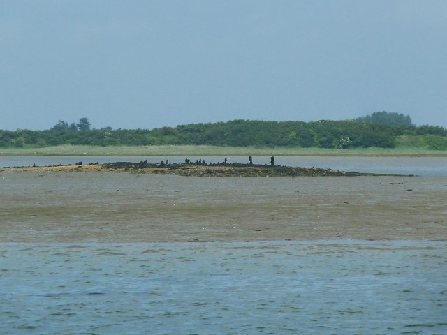 Pile remnants on tiny sand islet