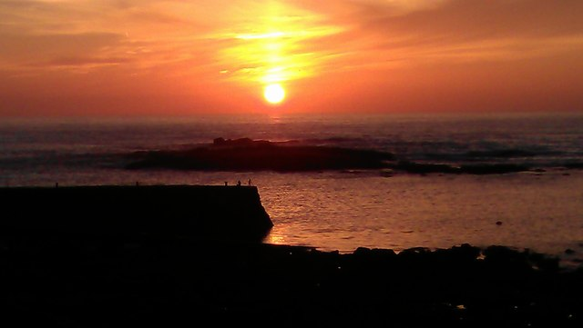 Sunset behind the Cowloe rocks at Sennen Cove