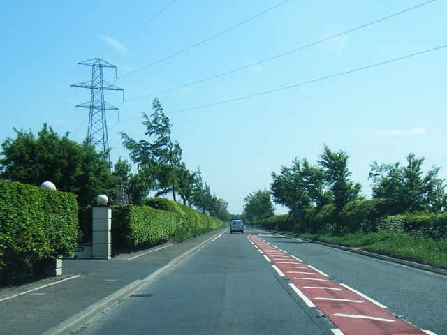 Power lines cross the A7 south of Longtown