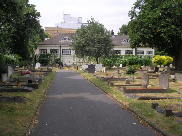 Earlsfield:  A corner of Wandsworth Cemetery with Earlsfield Library behind