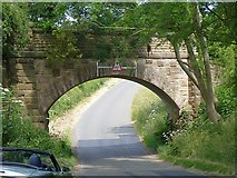 SK7724 : Disused railway bridge near Wycomb by Richard Green