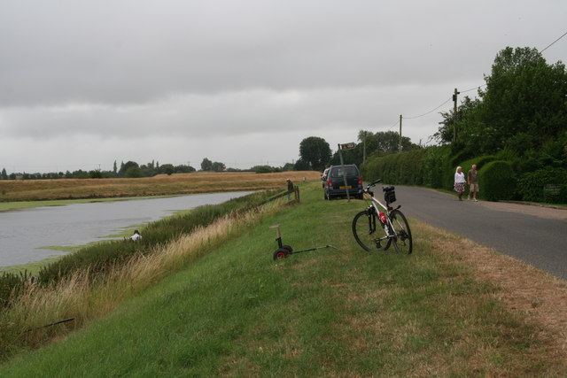 Holiday-makers and fishermen outside Holly Farm Country Park