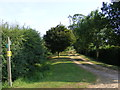 TM3084 : Footpath & entrance to College Farm by Adrian Cable