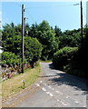 SO1241 : Road between poles outside Llanogen Cottage, Llanstephan by Jaggery
