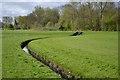 SP0665 : Curved drainage channel, Washford, Redditch by Robin Stott