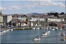 SH4862 : Caernarfon harbour and town by David C Williams