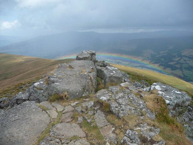 Low rainbow below the Sugar Loaf / Mynydd Pen-y-fâl