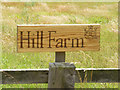 TM1959 : Hill Farm sign by Adrian Cable