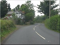 SO6466 : Roadside cottage, B4204 by Peter Whatley