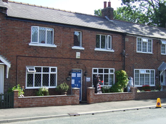 Cottage with scarecrows on West Street, Muston