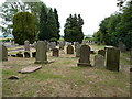 SJ4570 : Graves in Plemstall churchyard by Richard Law