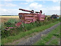 TL2383 : A combine abandoned years ago on Turf Fen by Richard Humphrey