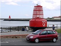 NZ3668 : Ornamental Buoy & South Groyne from Clifford Street, North Shields by Andrew Curtis