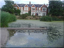 TQ1977 : Houses by the pond, Kew Green by David Howard