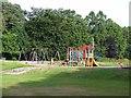 NO5969 : Children's playground, Edzell Muir by Oliver Dixon
