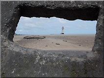SJ1285 : Talacre: the lighthouse through a concrete slot by Chris Downer