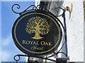 NZ5610 : Sign at the Royal Oak by John M