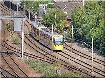 SJ8499 : Metrolink Tram Leaving Manchester by David Dixon
