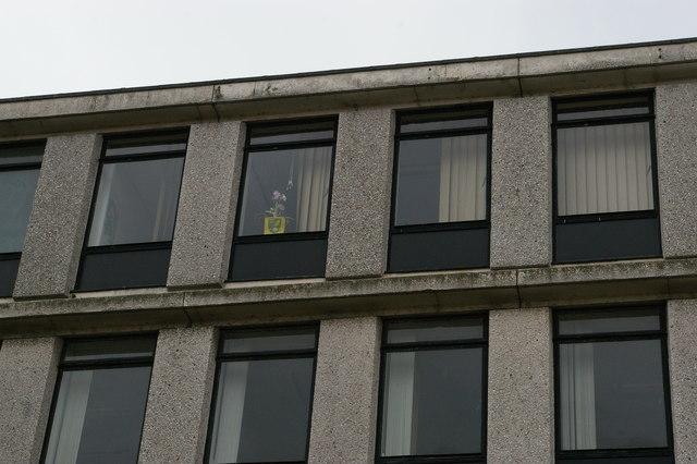 Boston: closed British Telecom building with forlorn Norwich City message