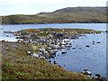NF9571 : The dun in Loch na Caiginn by John Allan