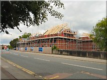 SJ9495 : New homes by Manchester Road by Gerald England