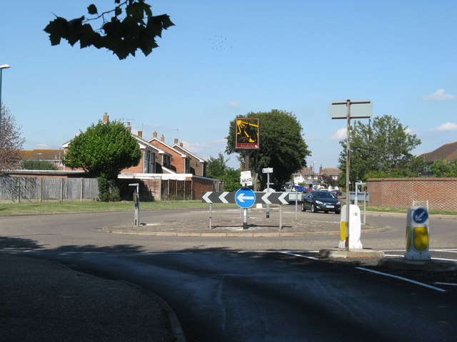 Pagham village sign in middle of roundabout