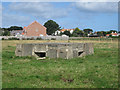 NU2328 : Pillbox in a field, Beadnell by Graham Robson