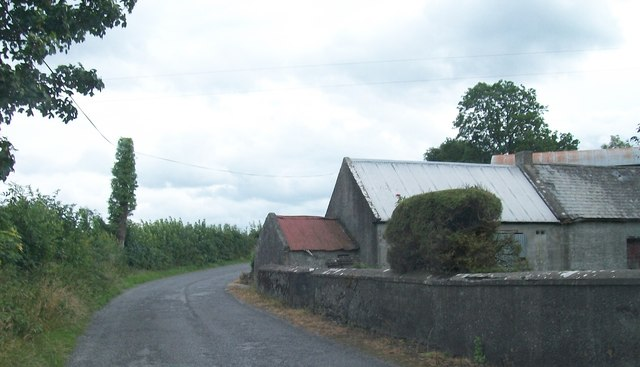Traditional farm buildings on a bend at the northern end of the L7012