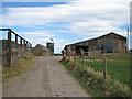 NZ9110 : Public bridleway through Brook House Farm by Pauline E