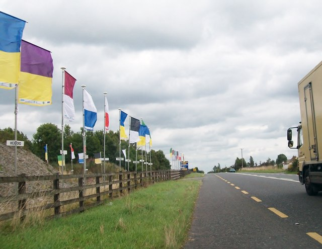 Irish county GAA colours display at the entrance to Kilsaran's Bunaterin Quarry on the N52