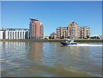 TQ3778 : Police river boat passing riverside apartments on the Isle of Dogs by Helen Steed