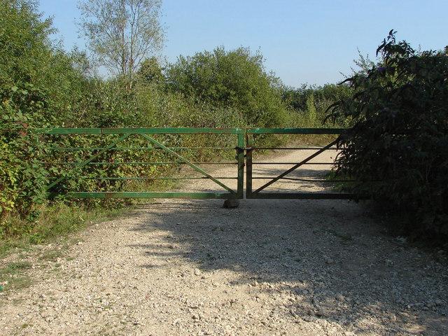Metal gate on gravel pit track