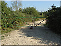 TQ0175 : Metal gate on gravel pit track by Alan Hunt