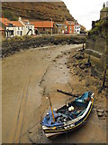 NZ7818 : Boat beside Staithes Beck by JThomas