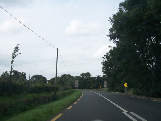 No overtaking signs at the approach to the L6835 cross roads on the N52 at Barfordstown