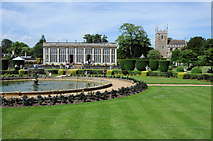 SK9239 : Orangery and church at Belton by Philip Halling